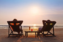 Couple enjoy sunset. Happy couple enjoy sunset on the beach Royalty Free Stock Photo