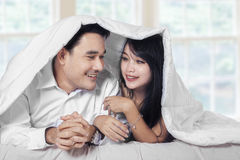 Couple enjoy togetherness on bed Royalty Free Stock Photos