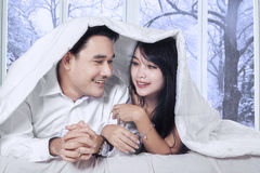 Couple enjoy winter day on bed Royalty Free Stock Photo