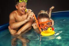 Couple is enjoyin in pool Royalty Free Stock Photography