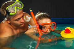 Couple is enjoyin in pool Royalty Free Stock Photos