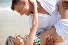 Couple enjoying at the beach Stock Photo