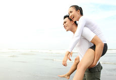 Couple enjoying the beach Stock Image