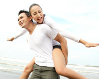 Couple enjoying the beach Stock Photography