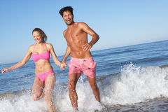 Couple Enjoying Beach Holiday Royalty Free Stock Image