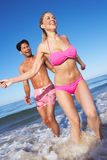 Couple Enjoying Beach Holiday Stock Photo