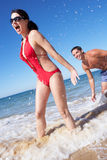 Couple Enjoying Beach Holiday Royalty Free Stock Photos