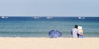 A couple enjoying on the beach in Nha Trang, Vietnam Royalty Free Stock Photo
