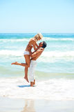 Couple enjoying at the beach during vacation Stock Photos