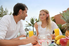 Couple enjoying beakfast time Royalty Free Stock Photos