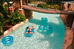 Couple enjoying beautiful sunny day on lazy river at Aquatica Water Park in International Dri stock photo
