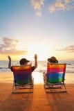 Couple Enjoying Beautiful Sunset. Happy Romantic Couple Enjoying Beautiful Sunset at the Beach stock images