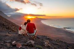 Couple enjoying beautiful sunset on Fuerteventura island Stock Photography