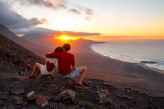 Free Couple Enjoying Beautiful Sunset On Fuerteventura Island Stock Images - 67750724