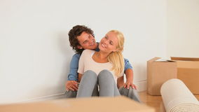Couple enjoying being in their new livingroom Stock Photos