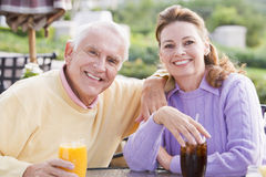 Couple Enjoying A Beverage By A Golf Course Stock Photography