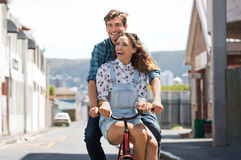 Couple enjoying bicycle ride royalty free stock image