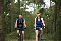 Couple enjoying a bike ride in nature Royalty Free Stock Photos