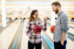 Couple enjoying bowling together Stock Images