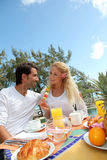 Couple enjoying breakfast Stock Photos