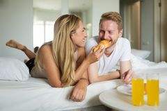 Couple enjoying breakfast in bed Royalty Free Stock Photo