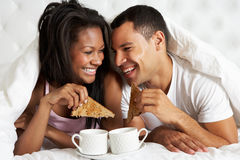 Couple Enjoying Breakfast In Bed Royalty Free Stock Photography