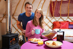 Couple Enjoying Breakfast Camping In Traditional Yurt Royalty Free Stock Photos