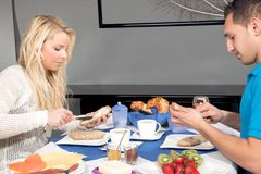 Couple enjoying breakfast together at home Stock Image