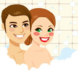 Couple Enjoying Bubble Bath. Young beautiful couple enjoying relaxing bubble bath happy together Royalty Free Stock Image