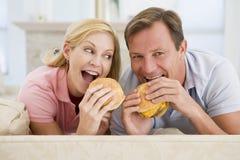 Couple Enjoying Burgers Together Stock Photography