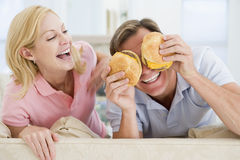 Couple Enjoying Burgers Together Royalty Free Stock Images