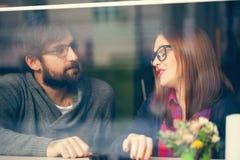 Couple Enjoying In Cafe Stock Image