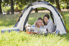 Couple Enjoying Camping Holiday In Countryside stock photography