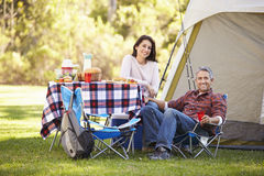 Couple Enjoying Camping Holiday In Countryside Stock Image