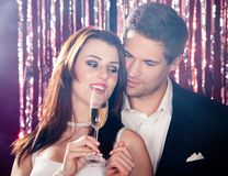 Couple enjoying champagne at nightclub Royalty Free Stock Photos