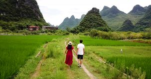 Couple enjoying the Yangshuo villages scenery. Couple enjoying in Chinese villages scenery in Yangshuo aerial footage stock video