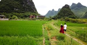 Couple enjoying the Yangshuo villages scenery stock video
