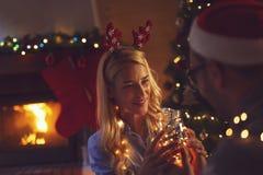 Couple enjoying Christmas Eve stock photo