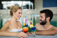 Couple enjoying cocktail in bath Royalty Free Stock Photos