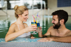 Couple enjoying cocktail in bath Stock Image