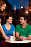 Couple enjoying coffee in cafe Stock Photography