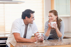 Couple enjoying coffee in the kitchen together Stock Photography