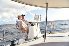 Couple enjoying cruise on a sailing boat Stock Image