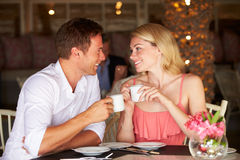 Couple Enjoying Cup Of Coffee In Restaurant Stock Photography