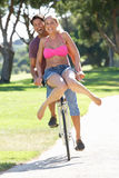 Couple Enjoying Cycle Ride Stock Photo