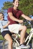 Couple Enjoying Cycle Ride Stock Photo