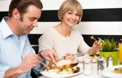 Couple enjoying delicious breakfast. Weekend outing, couple enjoying a meal Stock Photo