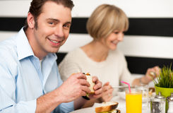 Couple enjoying delicious breakfast. Weekend outing, couple enjoying a meal Royalty Free Stock Images