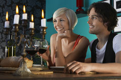 Couple Enjoying Dinner Party Stock Photo