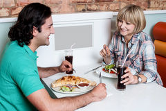 Couple enjoying dinner at a restaurant Royalty Free Stock Photos